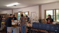 Interact serving at food pantry 2.jpg