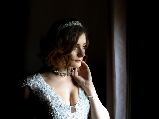 Dunston hall wedding in norwich norfolk bride window light