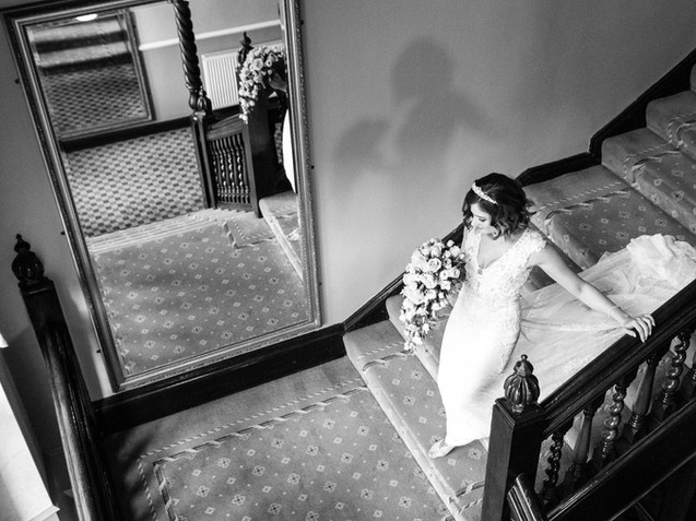 Dunston hall wedding in norwich norfolk black and white stairs