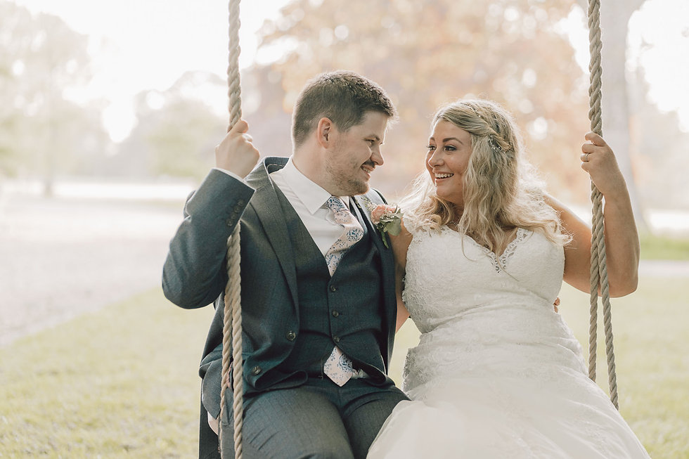 Bride and groom swing at Hockwold Hall