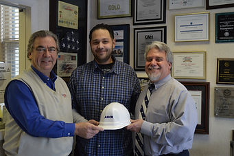 Auch donates hardhats for Liberia.
