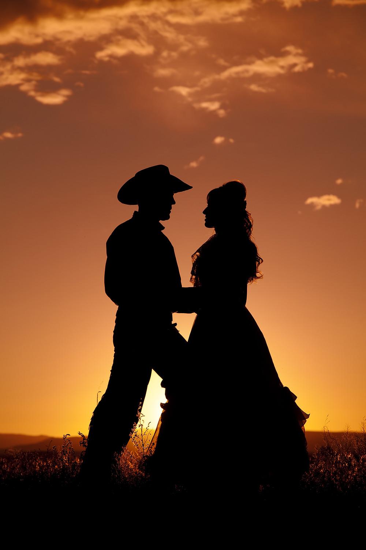 bigstock-Cowboy-Couple-Silhouette-In-Lo-23886374.jpg