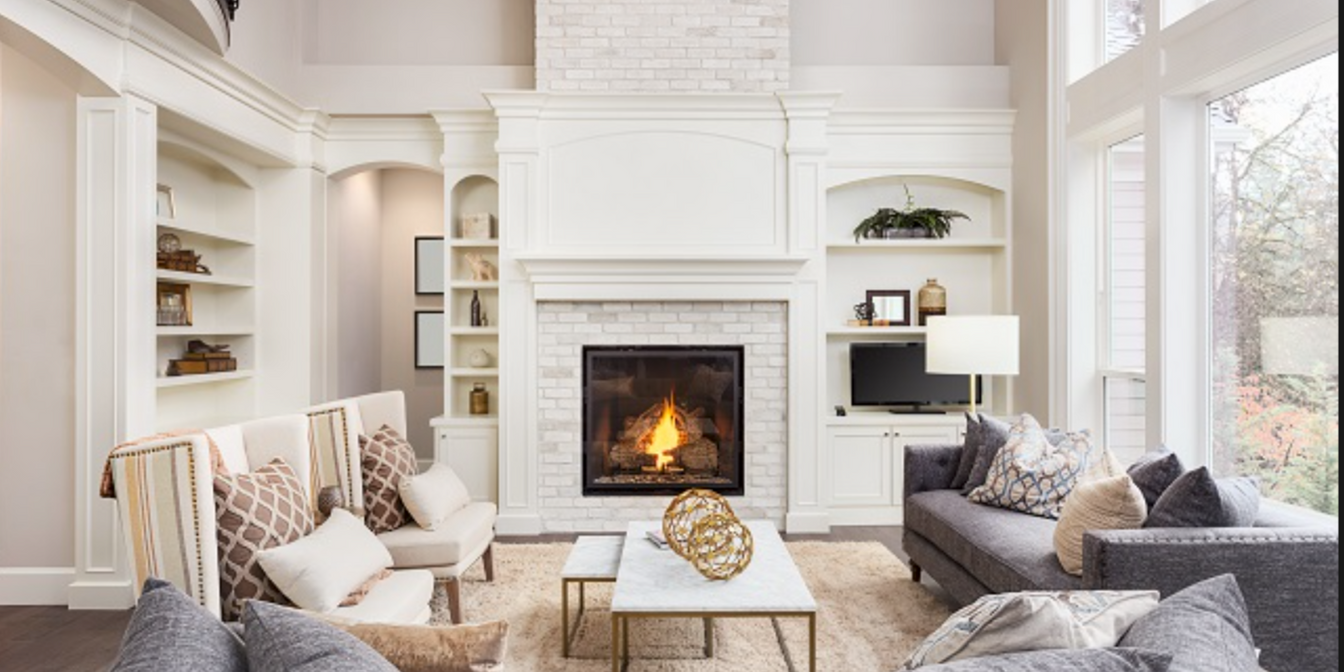 living room with fireplace and large window