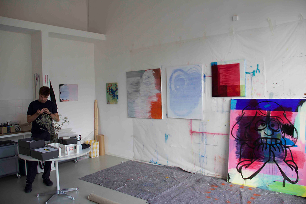 Jon Merz in his studio with several works in progress
