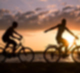 People riding bikes on the beach
