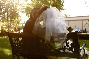 Wedding- Couple on bench (soft; sun).jpg