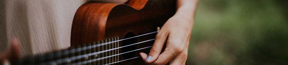 music-woman-playing-ukulele-at-daytime-guitar-guitar-image.jpg