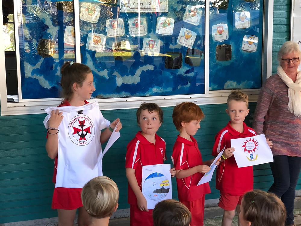 Students displaying their ambulance logos