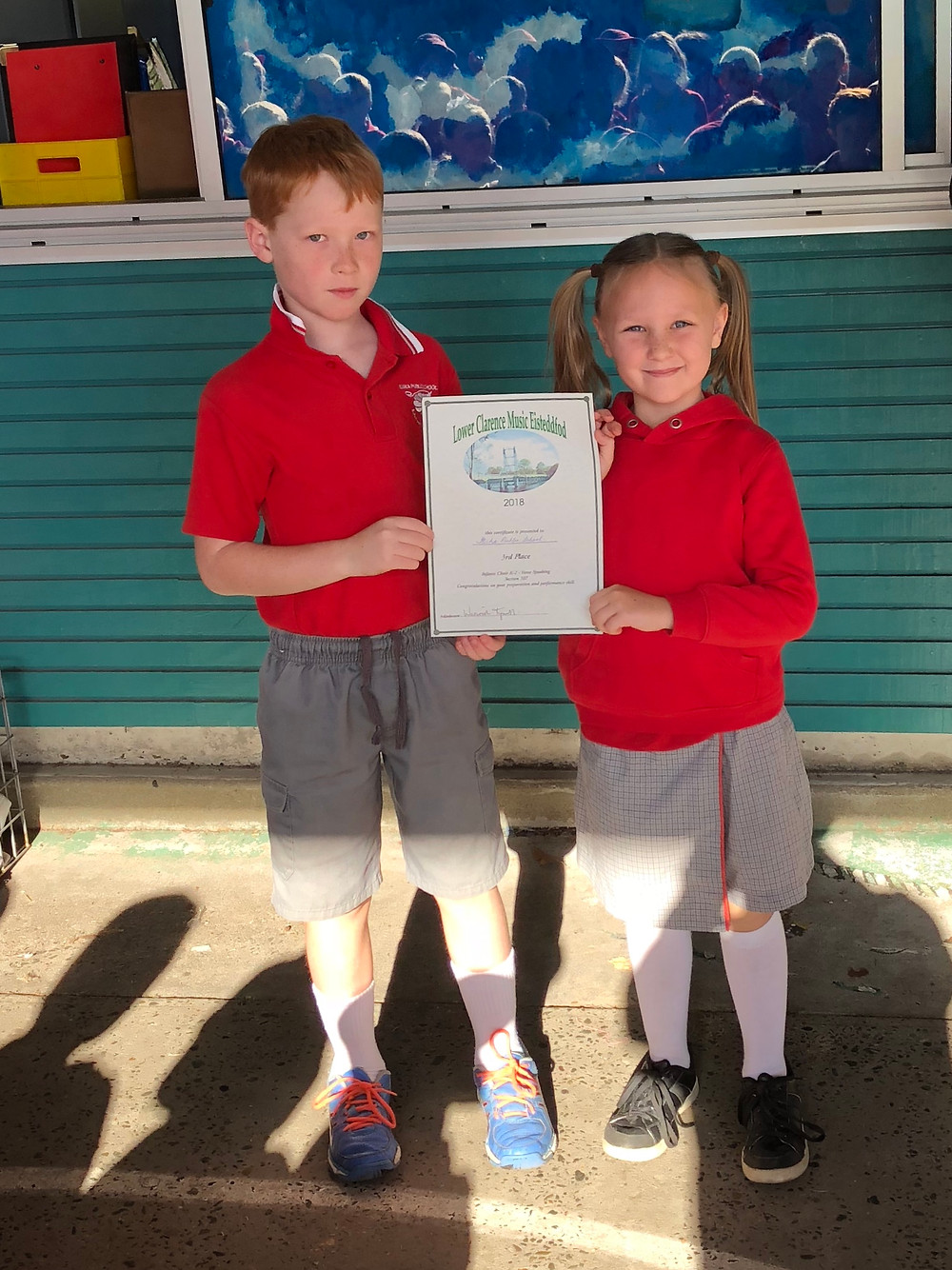 students holding award from Lower Clarence Music Eisteddfod