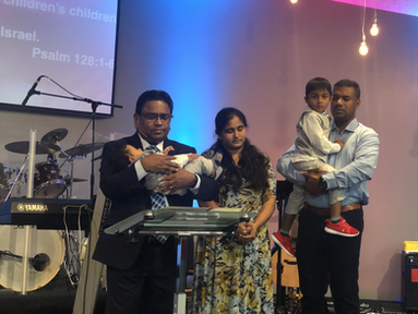 Pastor dedicating a baby