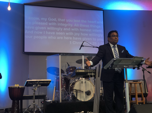 Pastor Austin preaching
