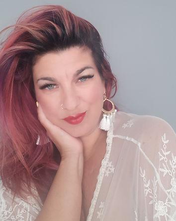 Gina Hatzis headshot white.jpg