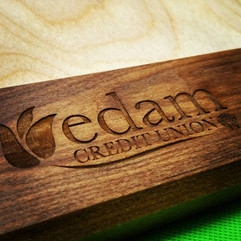 Engraved logo on wood for Edam Credit Un