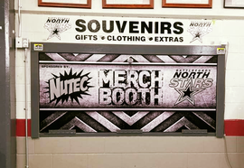 Door wrap and decals at the Merch Booth