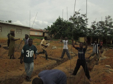 Villagers digging the foundations.