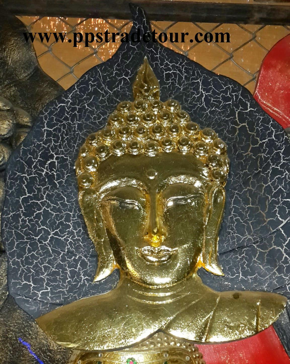 BuddhaFaceCarved4