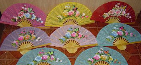 Paper hand fans painted