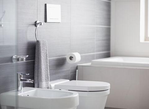 gray bathroom, hamptons bathroom design, Hamptons style bathroom,transitional Bathroom design, bidet, modern tub, drop in bathtub, porcelain tile, gray wall tiles, large wall tiles