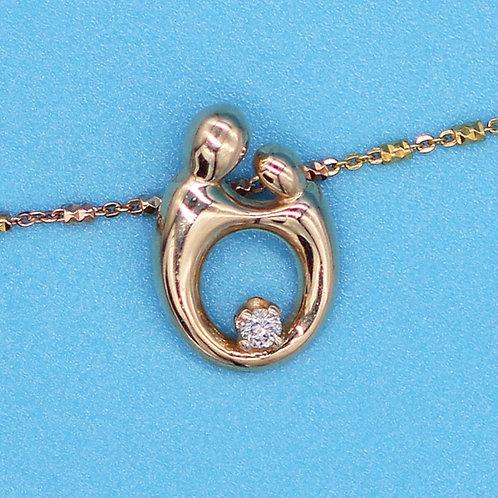 14 K Yellow Gold Pendant of Mother & Child, 5 Point Diamond