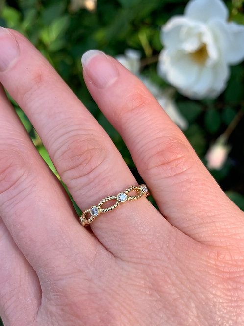 14 K Yellow Gold Diamond Band with Open Twist Design
