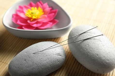 Acupuncture needles with stones on bambo