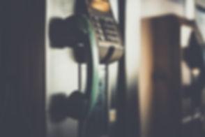selective-focus-photo-of-green-telephone