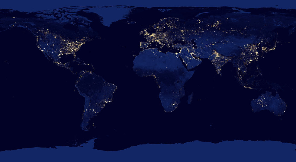 A satellite image of the earth at night with lights showing density of human habitation