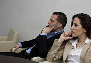 Man and woman listening to a presentation