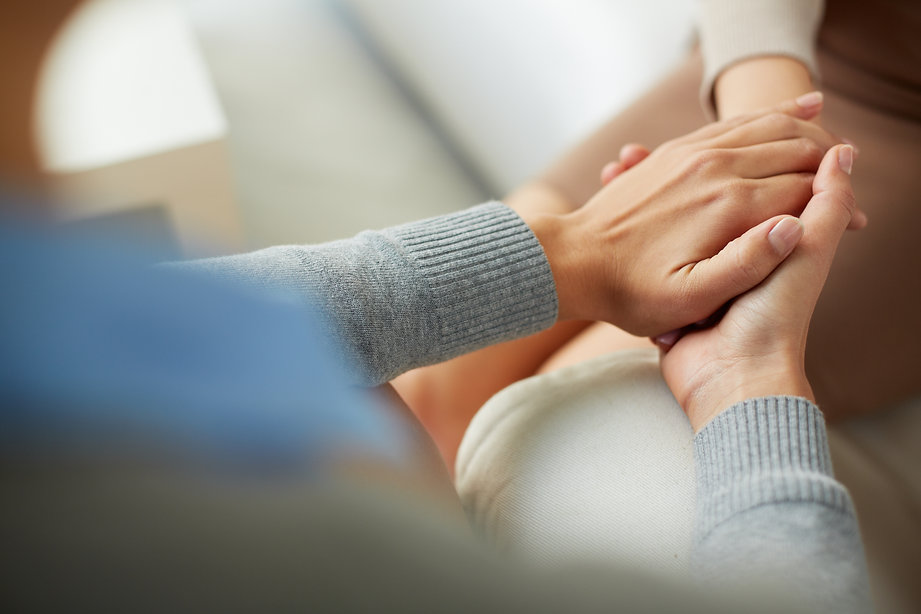Close-up of psychiatrist hands together