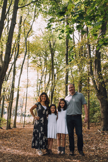 Lifestyle portrait of a family in the forest