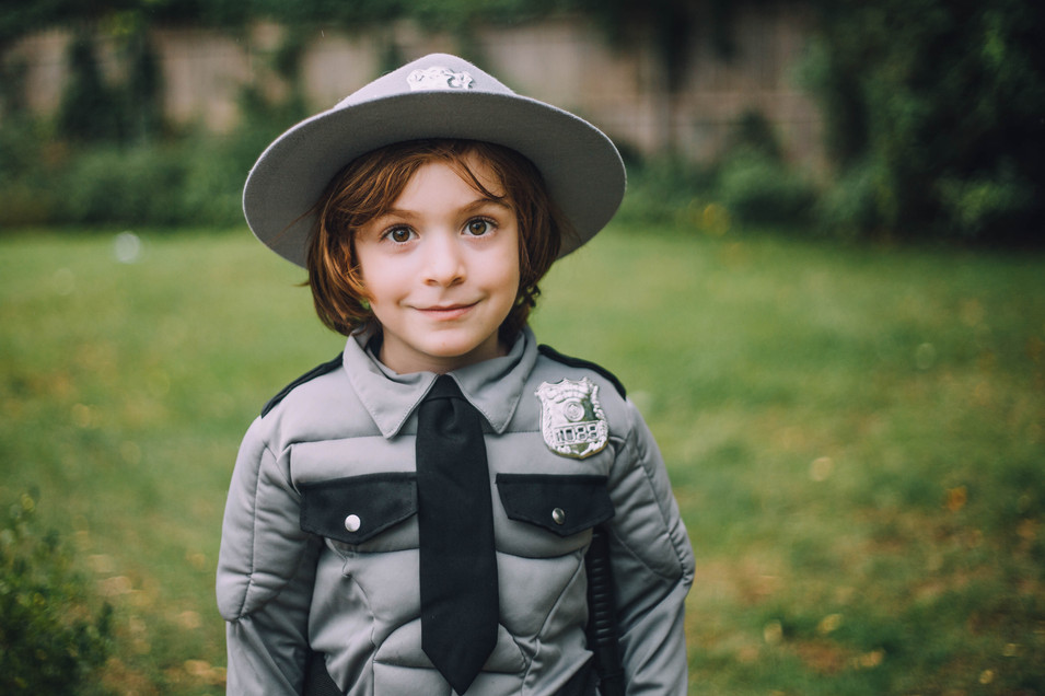 Lifestyle portrait of a young boy in Halloween costume