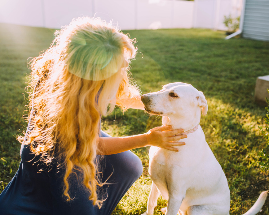 Lifestyle picture of a woman and her dog.