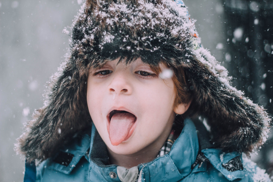 Lifestyle photo of a young boy in the snow