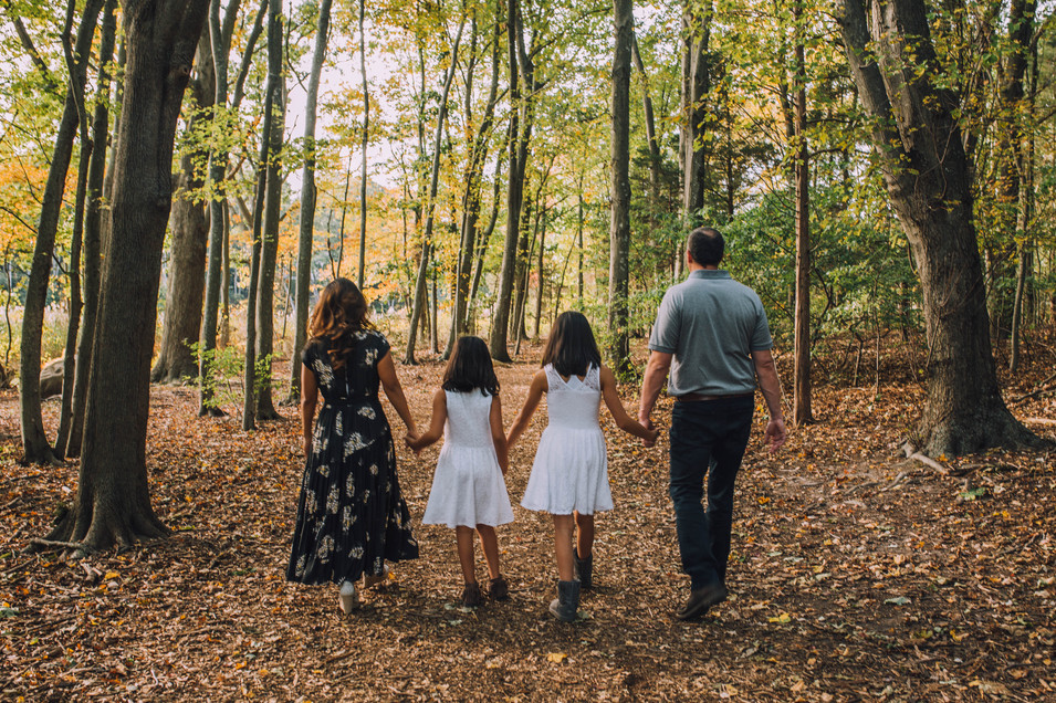 Lifestyle photo of a family in the woods