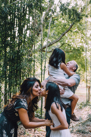Lifestyle photo of a family being affectionate