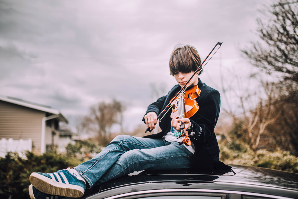 Lifestyle photo of a boy playing on a violin