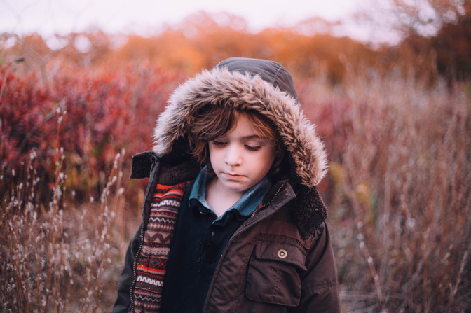 Lifestyle portrait of a boy in the fall