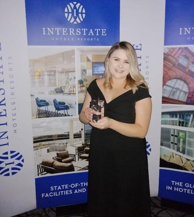 Stacey deRome - Sales Manager with her award