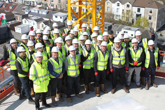 Create Construction & Crosslane celebrate Topping Out at Coppergate, Swansea