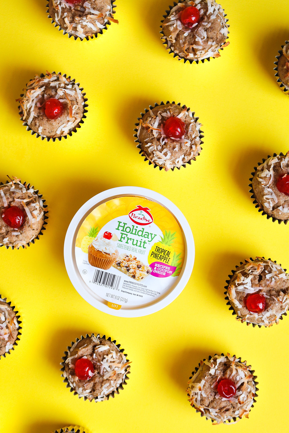 Vegan High Protein Tropical Banana Muffins garnished with Toasted Coconut and Paradise Candied Fruit Red Cherries