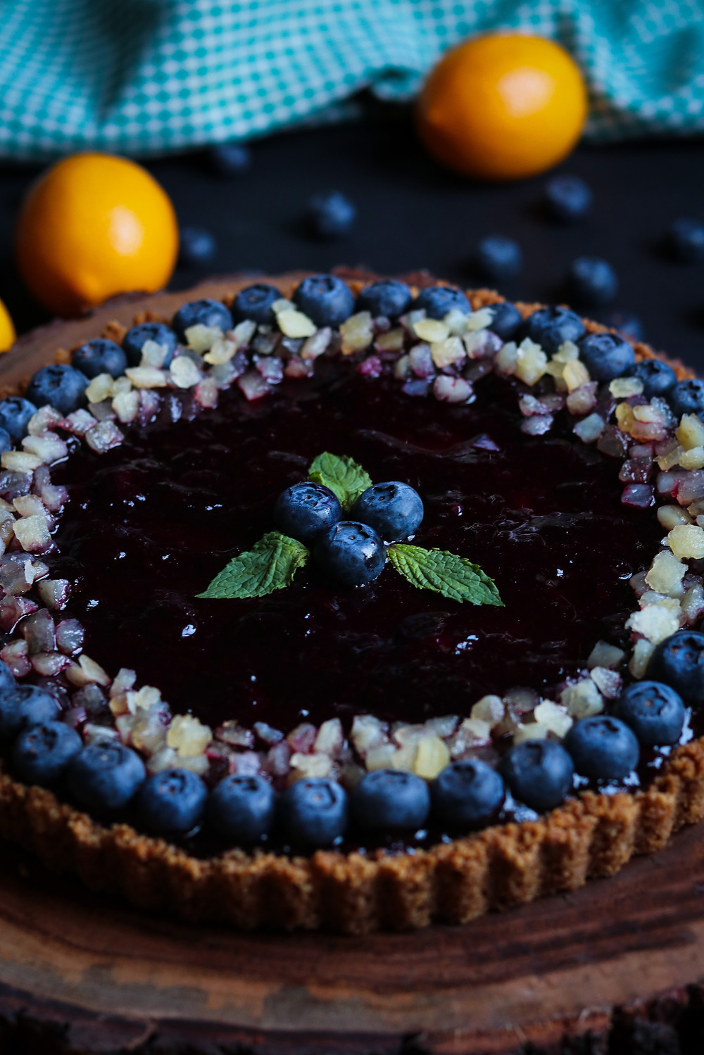 Lemon Blueberry Ricotta Cheesecake Tart with Blueberry Compote, Candied Lemon Peel, and Lemon Snap Crust