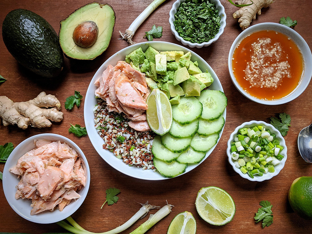 Sesame Ginger Salmon Grain Bowl served with Sesame Ginger Dressing, Avocado, and English Cucumber