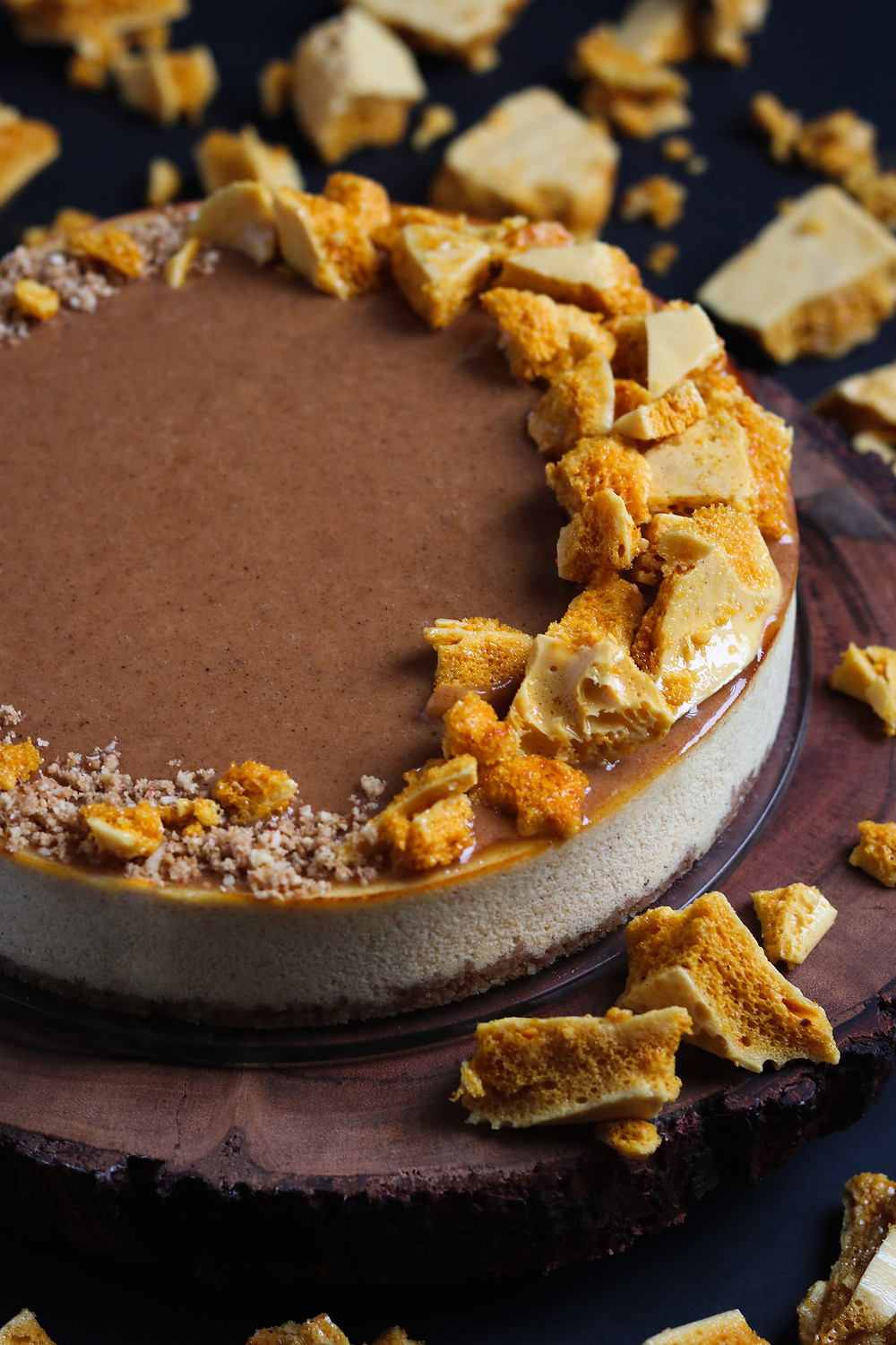 Honey Almond Ricotta Cheesecake with Honeycomb, Honey Almond Butter Glaze, and Toasted Almond Graham Cracker Crust