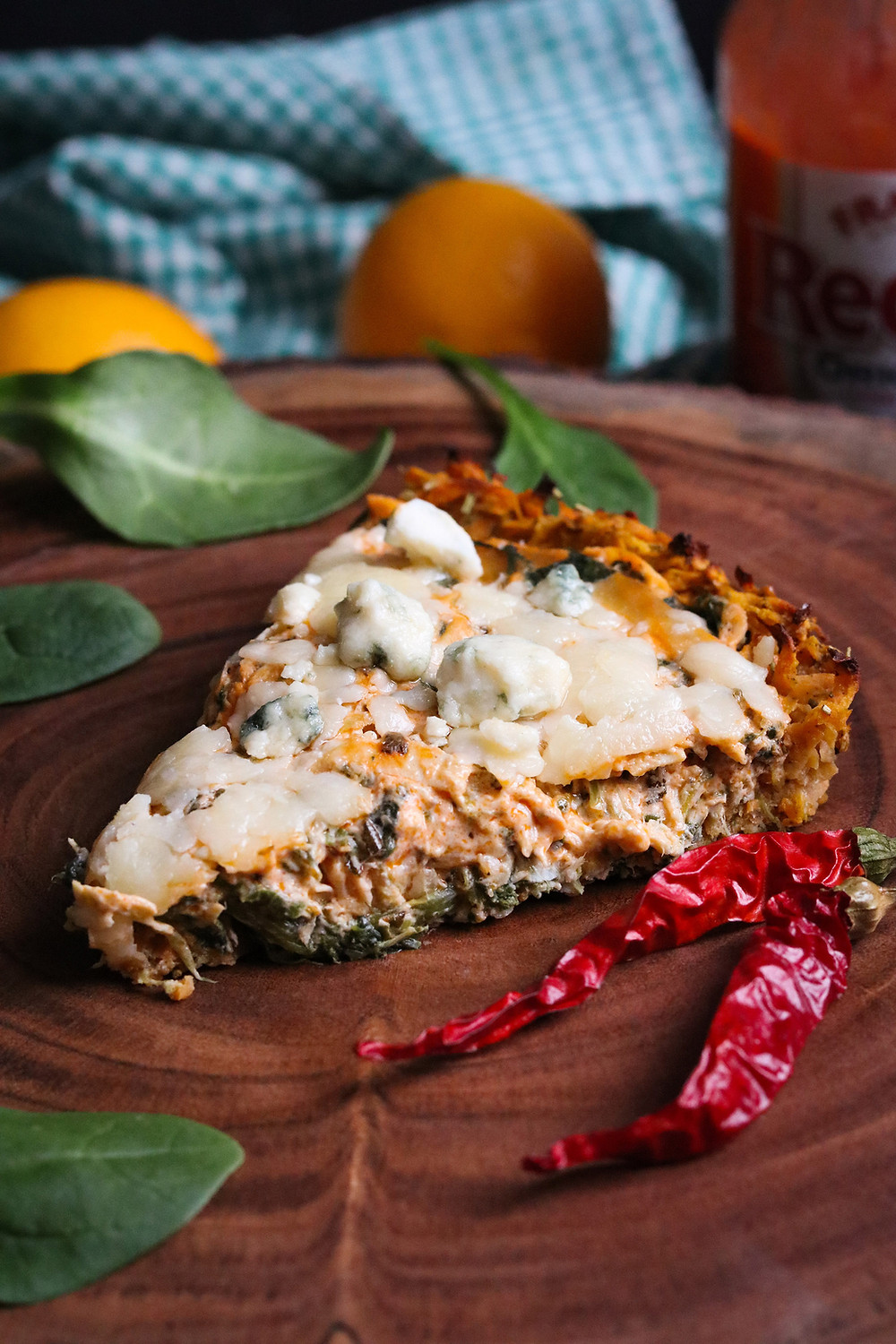 Rosemary Buffalo Chicken Tart with Slow Cooker Chicken, Sweet Potato Crust, Spinach, and Crumbled Gorgonzola