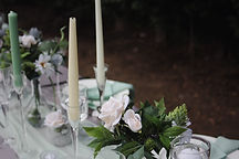 candle holder and flowers for table decorations