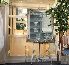 "<img src=""054-antique-ornate-easel-seating-plan-dr.jpg"" alt=""venue styling hire"">"