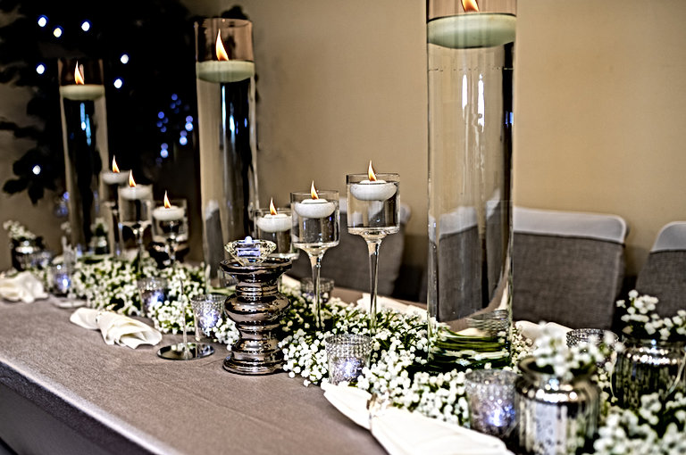 "<img src=""025-candles-holders-centrepiece.jpg"" alt=""venue styling"">"