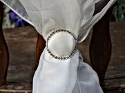 buckle on the white fabric for reception styling