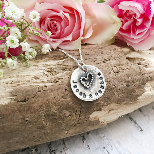 Rustic sterling silver hand stamped with beaded heart detail