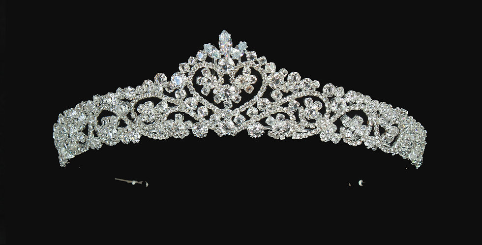 A lovely classic tiara handmade with each pearl flower and crystal leaf being hand wired and added to the design step by step